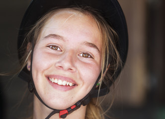 Portrait of a young woman equestrian wearing a black helmet;Mijas malaga andalusia spain