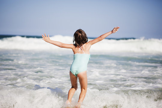 A young girl plays in the waves of the ocean;Gold coast queensland australia
