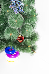 Christmas tree on which hangs a red toy with the word love on a white background