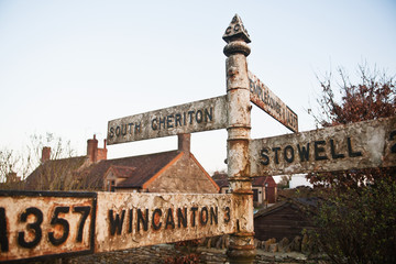 Old style road sign on A357 on the edge of South Cheriton village;Somerset England