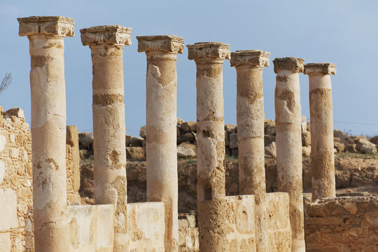 Old columns in a row against a blue sky;Paphos, cyprus