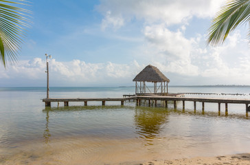 Pier on Boca del Drago beach in the evening, archipelago Bocas del Toro, Panama