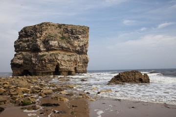 Large rock formation along the coastline at low tide;South shields tyne and wear england