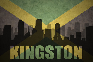 abstract silhouette of the city with text Kingston at the vintage jamaican flag