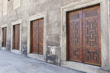 Four double doorways in a row along a wall at the blue mosque;Istanbul turkey
