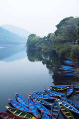 Boats in the famous Pokhara lake; Pokhara, Nepal