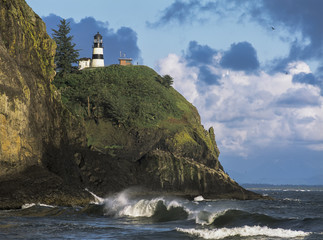 Waves break at Cape Disappointment Lighthouse; Ilwaco, Washington, United States of America