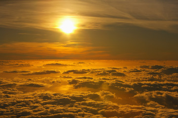 Sunset viewed above the clouds at Haleakala National Park; Maui, Hawaii, United States of America