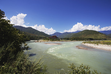 A river with mountains, blue sky and cloud; Punakha, Bhutan