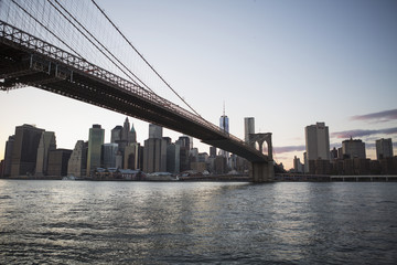 Brooklyn Bridge heading into Manhattan at dusk; New York City, New York, United States of America