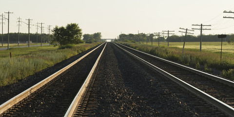Train tracks leading into the horizon on the prairies; Winnipeg, Manitoba, Canada