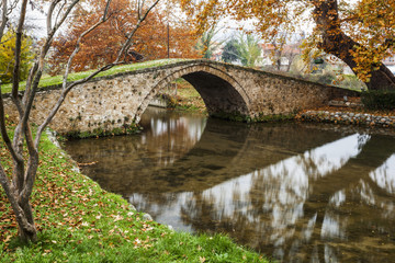 Stone bridge over a tranquil river; Edessa, Greece