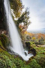 Waterfall from the Edessaios river with autumn coloured foliage; Edessa, Greece