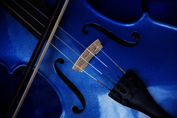 Detail of a violin with blue glitter varnish, music instrument background