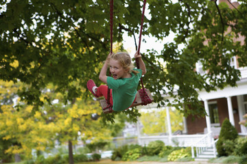 Young girl on a swing; Picton, Ontario, Canada