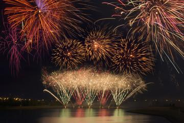 Fireworks reflecting on a lake; Calgary, Alberta, Canada