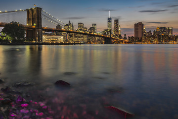 Lower Manhattan at twilight with the Brooklyn Bridge, Brooklyn Bridge Park; Brooklyn, New York, United States of America