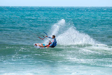 Amazing kite surfing at Philippines. Processional instructor surfing in ocean waives