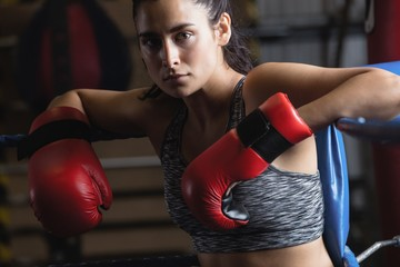 Portrait of female boxer in boxing gloves