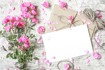 blank white greeting card with pink roses bouquet