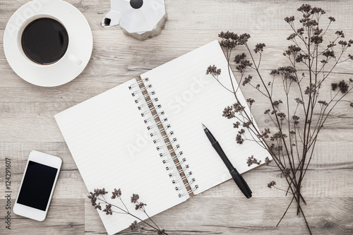 Open Scrapbook With Pen Coffee And Smartphone On Wooden Desk With