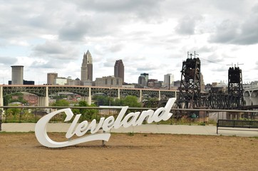 View of Cleveland sign and skyline on cloudy day