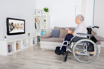 Grandmother Watching Movie On Television