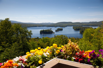 Beautiful view on the mountains lake from balcony with yellow an