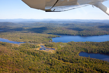 Adirondack forests, lakes, creeks and mountains aerial terrain v