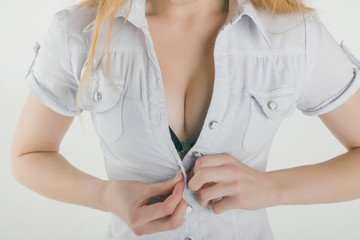 Beautiful woman sexy boobs in push-up bra and white shirt