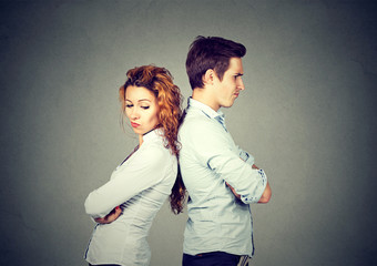Angry frustrated young couple standing back to back