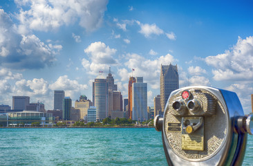 Binoculars overseeing Detroit city skyline