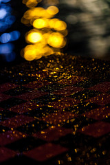 Bokeh and rain drops on a checker board
