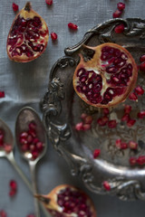 Pomegranate segments and seeds on a silver platter