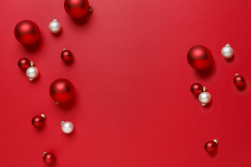 Christmas ornaments decorations background. Classic bright red and white glass baubles balls horizontal  border.