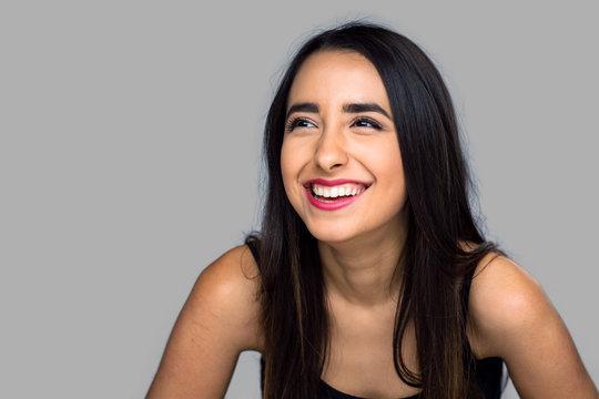 Cute pretty woman laughing hard big smile white teeth young latina hispanic girl isolated