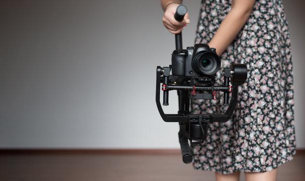 woman videographer using steady cam, Professional equipment help