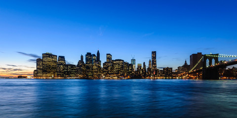 panorama of Manhattan Skyline at evening after sunset seen from Brooklyn Bridge Park, New York City, USA
