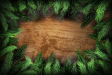 Christmas pine wreath on wooden background