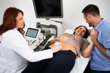 Husband and wife in a clinic, ultrasound consultation
