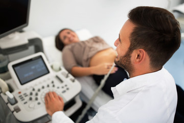Ginecologist doing ultrasound exam