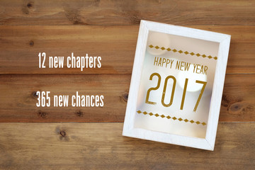 Happy new year 2017 on white vintage wooden frame background