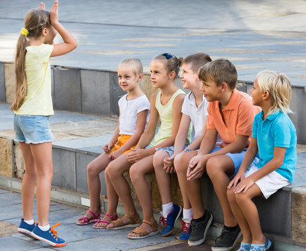 portrait of  children spending time outside and playing charades
