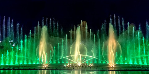 Musical fountain with colorful illuminations at night.
