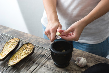 Woman Preparing Roasted Eggplants