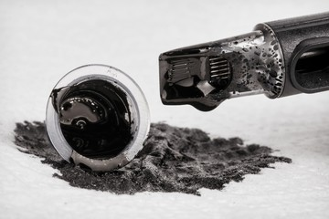 Tattoo machine with needle and ink. Stock image, macro shot.