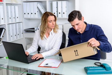 businessman and businesswoman with delivery in the office