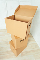 Big cardboard boxes standing insinde a room