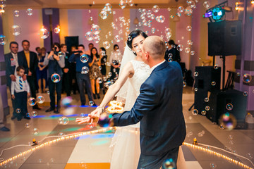 Wedding dance with  bubbles. Bride and groom whirl in restaurant. dancing couple