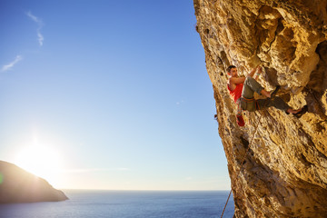 Rock climber on overhanging cliff. Kalymnos Island, Greece.